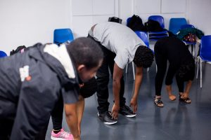 The participants are lead in a warm-up by Che Walker, before jumping into devising pieces for their final performance.