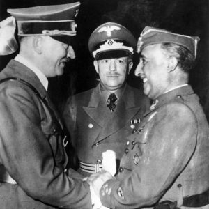 Here is Franco (the man with the cap on) looking very pleased and happy to be meeting with Hitler.