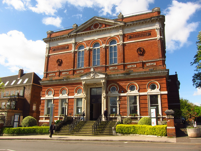 Image of the front of the Old Hampstead Town Hall, red brick with edwardian architectural features